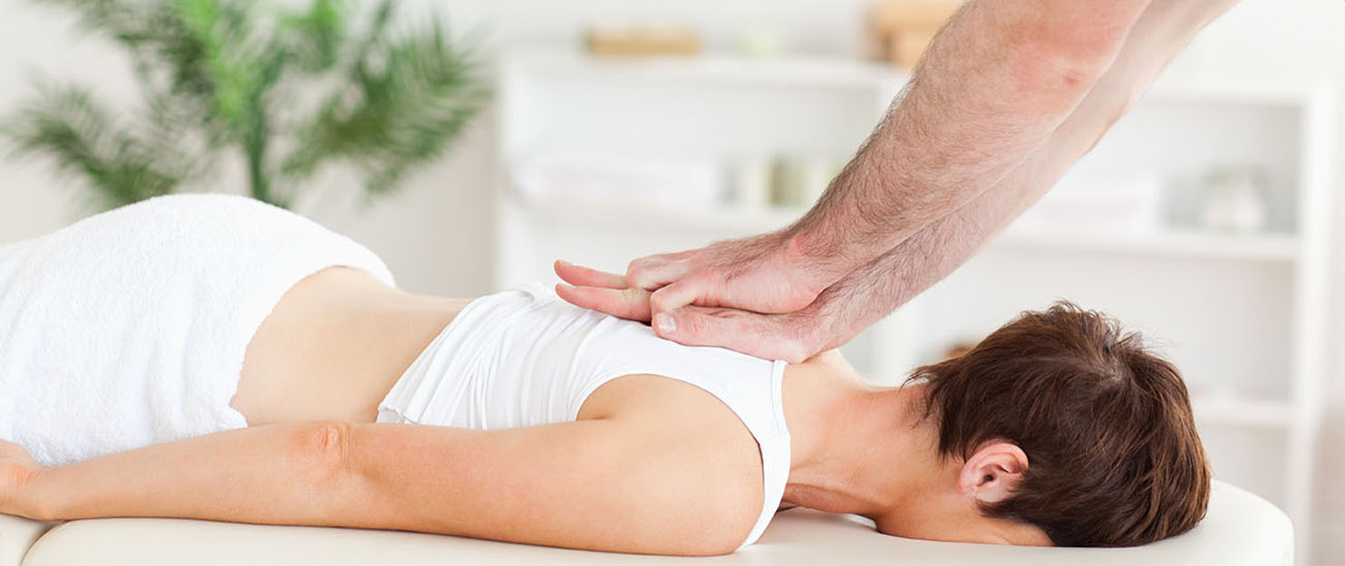 Woman getting chiropractic care in Kenosha.