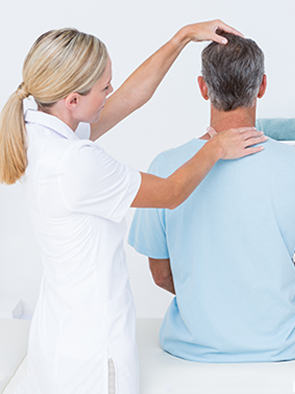 Chiropractor in kenosha does an adjustment on patient with headache