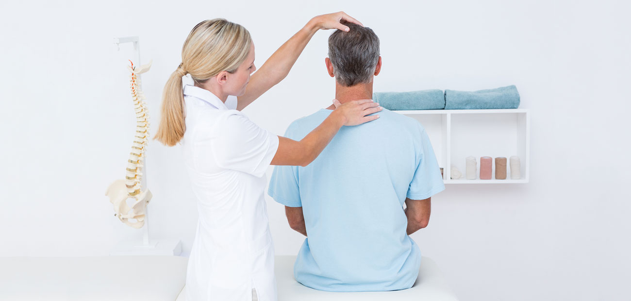 chiropractor gives patient an adjustment on his neck after an auto accident